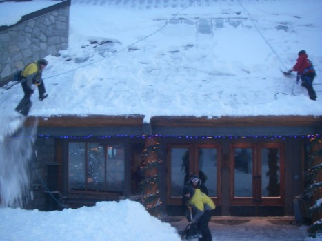 Mountain Safety Crew Shoveling Grouse Chalet Roof